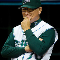 Tampa Bay Devil Rays  manager Joe Maddon smiles before being introduced for the first time at Tropicana Field against the Baltimore Orioles in St. Petersburg, Florida on April 10, 2006. REUTERS/Scott Audette