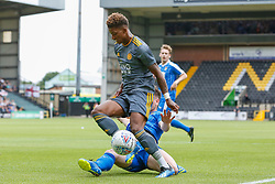 Richard Duffy of Notts County slides in to tackle Demarai Gray of Leicester City - Mandatory by-line: Ryan Crockett/JMP - 21/07/2018 - FOOTBALL - Meadow Lane - Nottingham, England - Notts County v Leicester City - Pre-season friendly