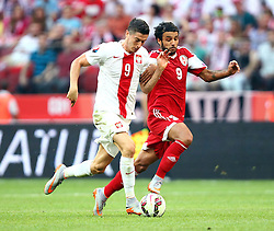 13.06.2015, Nationalstadion, Warschau, POL, UEFA Euro 2016 Qualifikation, Polen vs Greorgien, Gruppe D, im Bild ROBERT LEWANDOWSKI ( POL ) TORNIKE OKRIASHVILI ( GEO ) // during the UEFA EURO 2016 qualifier group D match between Poland and Greorgia at the Nationalstadion in Warschau, Poland on 2015/06/13. EXPA Pictures © 2015, PhotoCredit: EXPA/ Pixsell/ MICHAL NOWAK<br /> <br /> *****ATTENTION - for AUT, SLO, SUI, SWE, ITA, FRA only*****
