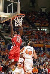 02 January 2004 Greg Dilligard gets past Luther Head and pulls up at the basket ahead of the approaching Augustine. Illinois State University ties up The Fightin Illini in regulation but fails to top the Big 10 team in overtime. Action took place at the Assembly Hall on the University of Illinois Campus in Champaign - Urbana Illinois.