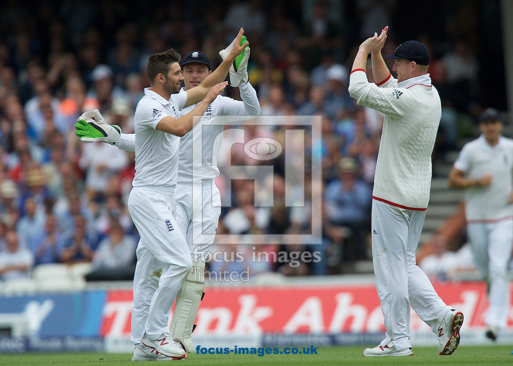 Bowler Mark Wood of England is congratulated on his wicket by Wicketkeeper Jos Buttler and Ben Stokes (right) during the 5th Investec Ashes Test Match match at the Kia Oval, London<br /> Picture by Alan Stanford/Focus Images Ltd +44 7915 056117<br /> 20/08/2015