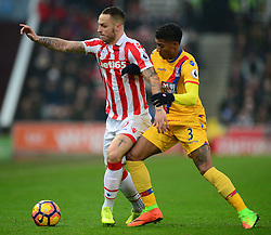 Marko Arnautovic of Stoke City shields the ball from Patrick van Aanholt of Crystal Palace - Mandatory by-line: Alex James/JMP - 11/02/2017 - FOOTBALL - Bet365 Stadium - Stoke-on-Trent, England - Stoke City v Crystal Palace - Premier League