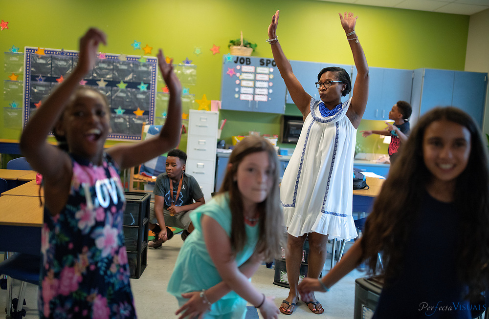 Last day of school at Ronald E. McNair Elementary School.<br /> <br /> Regina Freeland dances with her students.<br /> <br /> Photographed, Tuesday, June 12, 2018, in Greensboro, N.C. JERRY WOLFORD and SCOTT MUTHERSBAUGH / Perfecta Visuals