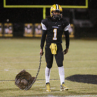Ripley's Antwon Knox pulls a bulldog head after he and the other seniors lined up for the coin toss before the start of Friday night's game against New Albany.