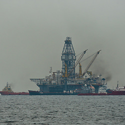 Support vessels are seen working near Transocean's Development Driller III leased by BP Plc which works to drill a the first relief well at the source of the BP Plc Deep Water Horizon oil spill site in the Gulf of Mexico off the coast of Louisiana, U.S., on Thursday, July 15, 2010. Photographer: Derick E. Hingle/Bloomberg