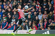 Julian Jeanvier (Brentford) & \Tom Lawrence (Derby County) during the EFL Sky Bet Championship match between Brentford and Derby County at Griffin Park, London, England on 6 April 2019.