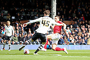 Nottingham Forest midfielder Chris Cohen (8) tackling Fulham defender, Fernando Amorebieta (45) during the Sky Bet Championship match between Fulham and Nottingham Forest at Craven Cottage, London, England on 23 April 2016. Photo by Matthew Redman.