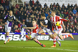 STOKE-ON-TRENT, ENGLAND - Sunday, January 12, 2014: Liverpool's Philippe Coutinho Correia in action against Stoke City during the Premiership match at the Britannia Stadium. (Pic by David Rawcliffe/Propaganda)