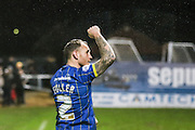 Barry Fuller (Captain) of AFC Wimbledon salutes the Dos fans at the final whistle during the Sky Bet League 2 match between Cambridge United and AFC Wimbledon at the R Costings Abbey Stadium, Cambridge, England on 2 January 2016. Photo by Stuart Butcher.