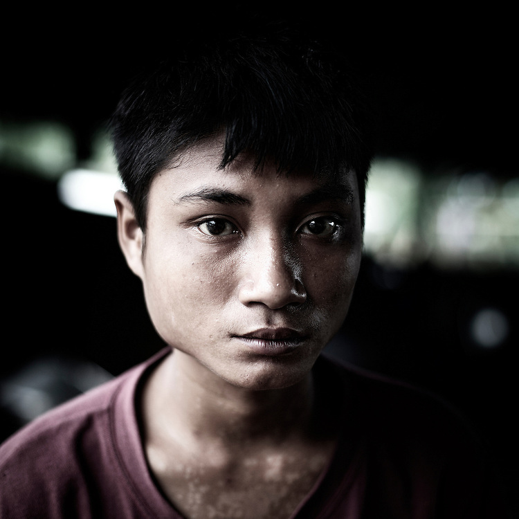 A Burmese Army child soldier's Pho La Pye, from Phya village and 17 years old, pose for a portrait in Kachin's jail of Woi Chyai for prisioners of war in Laiza village close to the China border, Myanmar on July 15, 2012. Was captured 1year ago near to Man Being region.