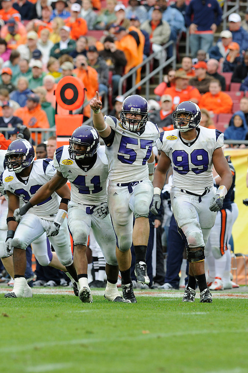 January 1, 2010: Nate Williams (57), Corey Wootten (99) and Quentin Davie (41) of the Northwestern Wildcats in action during the NCAA football game between the Northwestern Wildcats and the Auburn Tigers in the Outback Bowl. The Tigers defeated the Wildcats 38-35 in overtime.