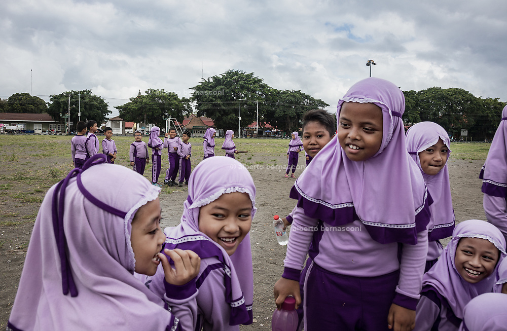 INDONESIA, Central Java, Yojakarta, school girla during a gym lesson in the main sqaure