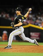 Sep. 20 2011; Phoenix, AZ, USA; Pittsburgh Pirates pitcher Jason Grilli(39) pitches during the seventh inning against the Arizona Diamondbacks at Chase Field.  Mandatory Credit: Jennifer Stewart-US PRESSWIRE..