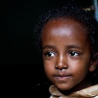 Girl in doorway in Delo Mena, south Ethiopia