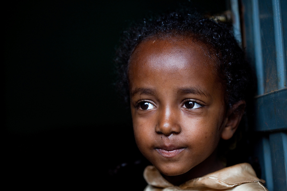Girl in doorway in Delo Mena, south Ethiopia