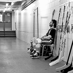 """FORT FRANCES, ON - May 2, 2015 : Central Canadian Junior """"A"""" Championship, game action between the Fort Frances Lakers and the Soo Thunderbirds, Championship game of the Dudley Hewitt Cup. A Soo Thunderbirds player takes a moment to himself prior to the start of the game.<br /> (Photo by Shawn Muir / OJHL Images)"""