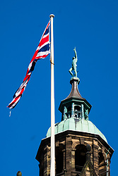 Against a clear blue sky the statue of Vulcan atop Sheffield Town hall stands looking almost defiant alongside the the Union Flag during the Coronavirus pandemic<br />    <br /> 22 March 2020<br /> <br /> www.pauldaviddrabble.co.uk<br /> All Images Copyright Paul David Drabble - <br /> All rights Reserved - <br /> Moral Rights Asserted -