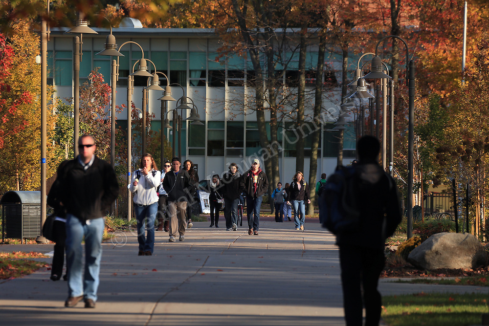 Students walk south from the University Center. Fall color features scenics at Central Michigan University. Central Michigan University photo by Steve Jessmore