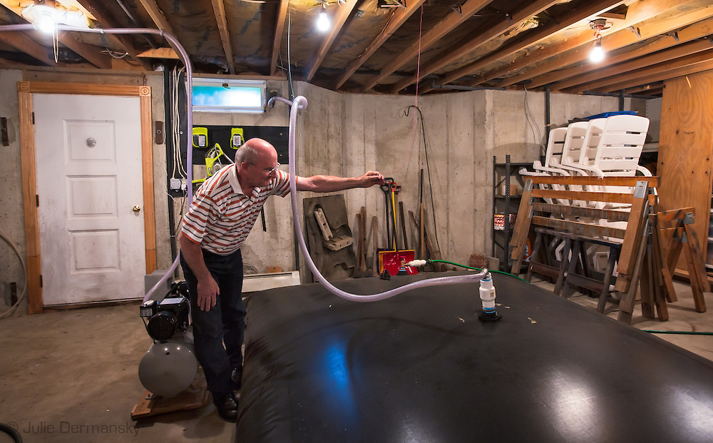 Andrew Chichura checking the water bladder in his basement, in Kingsley PA supplied by Cabot Oil.