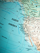 North America map on a globe focused on California coast and ocean currents