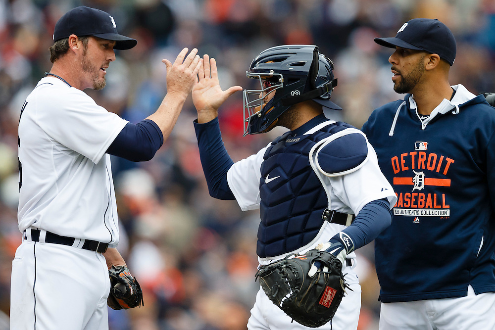 Apr 6, 2015; Detroit, MI, USA; Detroit Tigers relief pitcher Joe Nathan (left) catcher Alex Avila (center) and starting pitcher David Price (right) celebrate after the game against the Minnesota Twins at Comerica Park. Detroit won 4-0. Mandatory Credit: Rick Osentoski-USA TODAY Sports