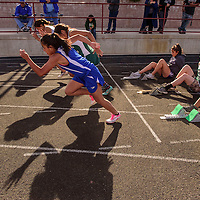 040315  Adron Gardner/Independent<br /> <br /> Girls runners leap out of the starting blocks during a 100m dash heat at Ramah High School Friday.