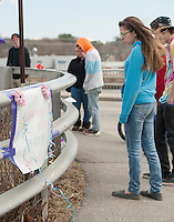 A stream of friends take a moment to remember as Saturday marks the one year anniversary and memorial gathering held for Lily Johnson. (Karen Bobotas/for the Laconia Daily Sun)