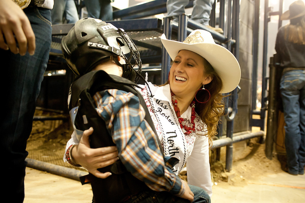 Krystal Carlascio, Miss Rodeo North Dakora 2013, with a young fan at a rodeo event at the National Western Stock Show.