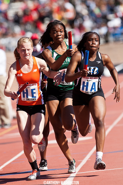 Allison Glossinger of McDonogh School and Yinka Alabi of Milford Mill High School battle for position during a High School Girls 4x400 heat at the Penn Relays on Thursday, April 24, 2014 in Philadelphia, PA.