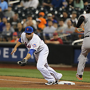 Lucas Duda, New York Mets, makes the out at first base as Delmon Young, Baltimore Orioles, lunges for the bag  during the New York Mets Vs Baltimore Orioles MLB regular season baseball game at Citi Field, Queens, New York. USA. 5th May 2015. Photo Tim Clayton