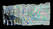 A lengthwise cross section of an icicle that is three days old. In this case the icicle grows rings similar to a tree. The age of an icicle can be determined by the number of heating and cooling cycles the icicle has gone through. This cross section is 2 mm thick and is photographed in polarized light.