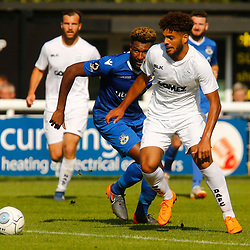 Dovers defender Josh Passley beats Eastleighs defender Réda Johnson during the National League match between Dover Athletic FC and Eastleigh FC at Crabble Stadium, Kent on 25 August 2018. Photo by Matt Bristow.