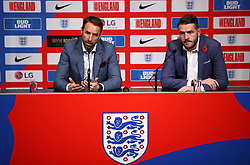 England Manager Gareth Southgate (left) and England's Senior Communications Manager Andy Walker during the press conference at Wembley Stadium, London.
