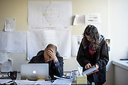 Philadelphia, Pennsylvania - September 16, 2015: Scott Mirkin and Jen Woo Co-Founders of ESM Productions, deals with last minute production issues in his downtown Philadelphia office Wednesday September 16, 2015. <br /> <br /> Their company ESM is heading the production of The World Meeting Of Families and Pope Francis's visit to Philadelphia this Fall. The events will take place along the Benjamin Franklin Parkway.<br /> <br /> CREDIT: Matt Roth for The New York Times<br /> Assignment ID: 30179397A