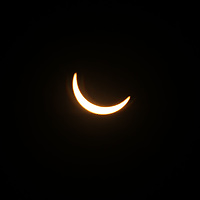 The soalr eclipse nears its fulliest at 1:23 p.m. while passing over Tupelo on Monday