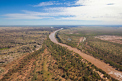 The Fitzroy River winds across the landscape upstream from Fitzroy Crossing.