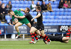 London Irish's Eamonn Sheridan is tackled - Photo mandatory by-line: Robbie Stephenson/JMP - Mobile: 07966 386802 - 05/04/2015 - SPORT - Rugby - Reading - Madejski Stadium - London Irish v Edinburgh Rugby - European Rugby Challenge Cup