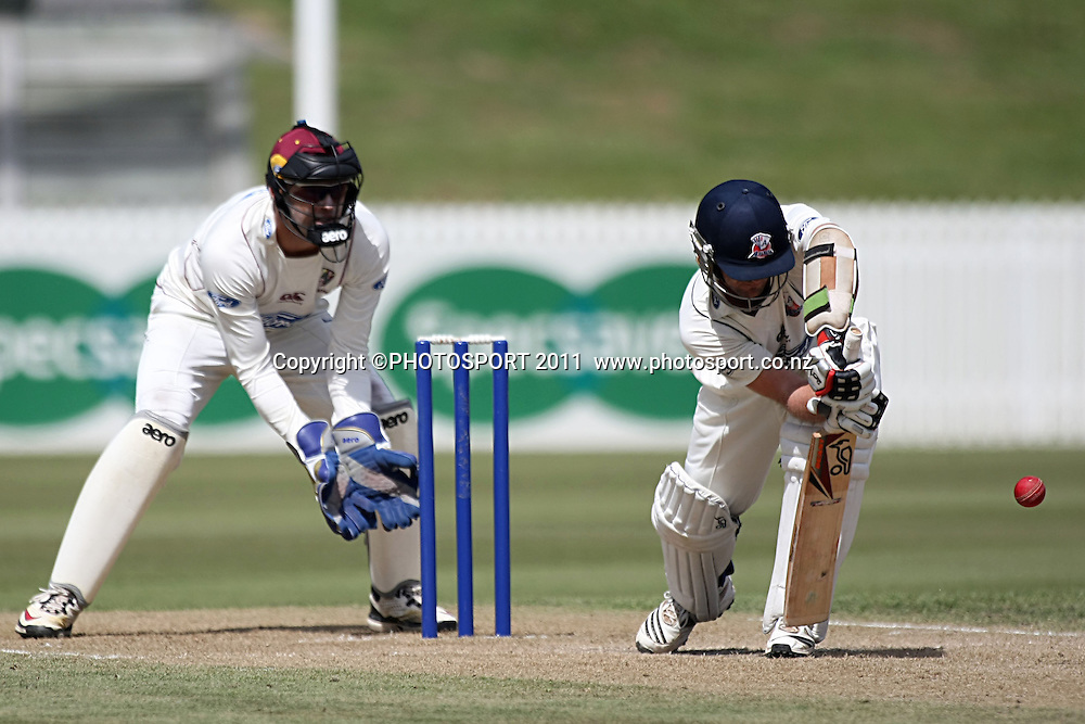 Auckland Ace's Gareth Hopkins in full defense mode as knights keeper Peter McGlashan looks on Cricket, Northern Knights Vs The Auckland Ace's during day two of their Plunket Shield Game at Seddon Park in Hamilton, Wednesday March 16 2011.<br /> Photo: Dion Mellow / photosport.co.nz