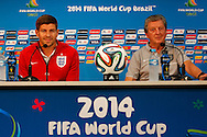 Steven Gerrard of England (L) and England manager Roy Hodgson (R) looks on during the England press conference at Arena da Amazonia, Manaus, Brazil.<br /> Picture by Andrew Tobin/Focus Images Ltd +44 7710 761829<br /> 13/06/2014