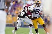 Baton Rouge, LA - SEPTEMBER 30:  Early Doucet #9 of the LSU Tigers gets tackled by Jeramie Johnson #34 of the Mississippi State Bulldogs at Tiger Stadium on September 30, 2006 in Baton Rouge, Louisiana.  The Tigers defeated the Bulldogs 48 - 17.  (Photo by Wesley Hitt/Getty Images) *** Local Caption *** Early Doucet; Jeramie Johnson