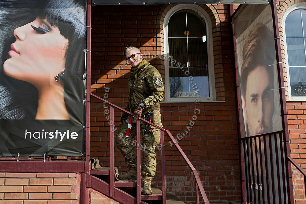 Julia Paevska is about to have a haircut in Bakhmut, a town in eastern Ukraine's conflict zone.