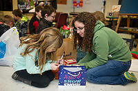 McKayla and Nikki wrap presents for McKayla's teacher and family members during Presents for Pleasant on Friday evening.  (Karen Bobotas/for the Laconia Daily Sun)