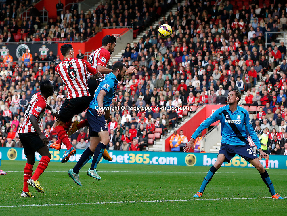 25th October 2014 - Barclays Premier League - Southampton v Stoke City - Graziano Pelle of Southampton gets a header on target from a corner - Photo: Paul Roberts / Offside.