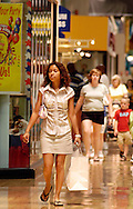 PHILADELPHIA, PA - JUNE 15:  Lorena Lacosta (C) carries her bags as she shops at Franklin Mills Mall June 15, 2005 in Philadelphia, Pennsylvania. (Photo by William Thomas Cain)