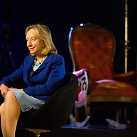 Dorris Kearns Goodwin being interviewed at The Henry Ford's Henry Ford Museum of American Innovation with the chair the Abraham Lincoln was assassinated in behind her.