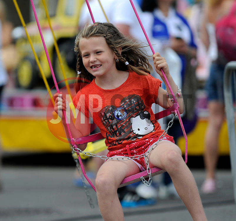 A girl goes on the swings at the fun day - Photo mandatory by-line: Dougie Allward/JMP - Mobile: 07966 386802 27/07/2014 - SPORT - FOOTBALL - Bristol - Bristol Rovers - - Memorial Stadium - Fun Day