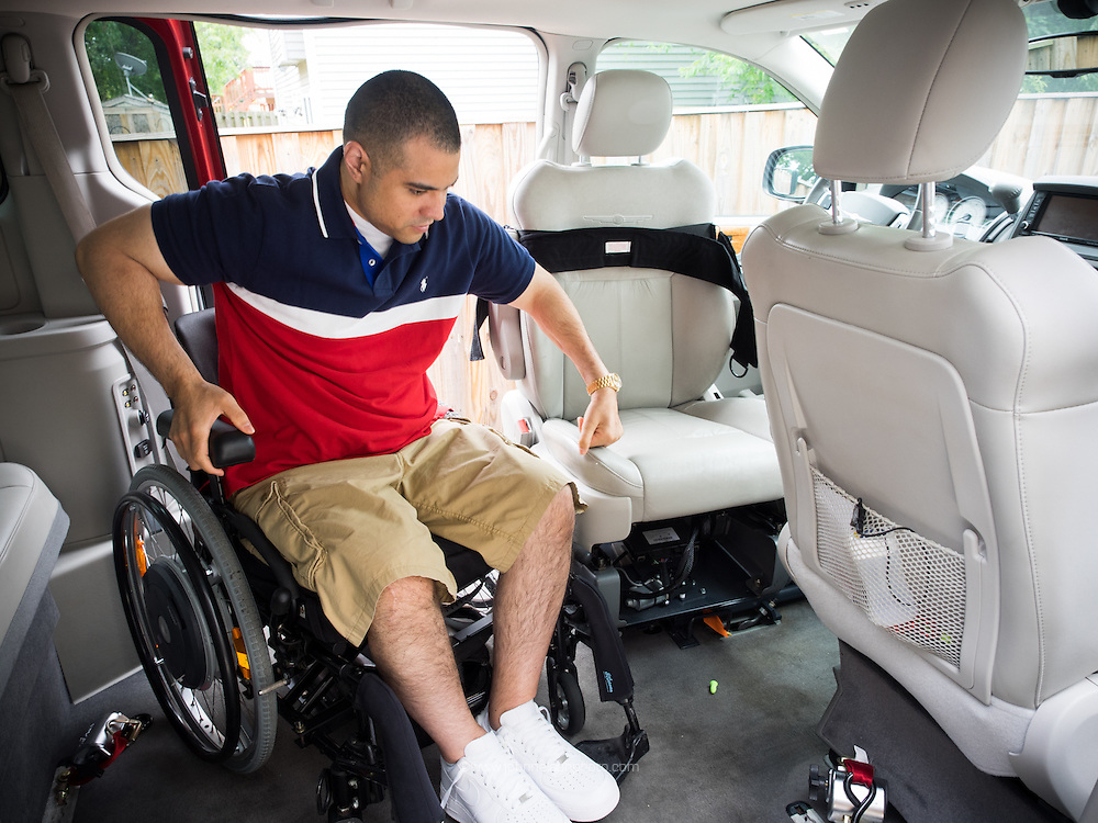 Afganistan war vet Josh Himan manuvers himself into the driver's seat in his custom van at his home in Woodbridge, VA.
