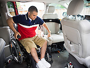 Afganistan war vet Josh Himan manuvers himself into the driver's seat in his custom van at his home in Woodbridge, VA.