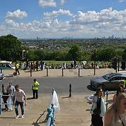 London Weather: People enjoy the Summer fantastic view of Lonodn at Alexandra Palace, on 25 May 2019, London, UK.
