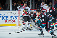 KELOWNA, CANADA - OCTOBER 20: James Porter #1 of the Kelowna Rockets defends the net behind Skyler McKenzie #43 of the Portland Winterhawks on October 20, 2017 at Prospera Place in Kelowna, British Columbia, Canada.  (Photo by Marissa Baecker/Shoot the Breeze)  *** Local Caption ***